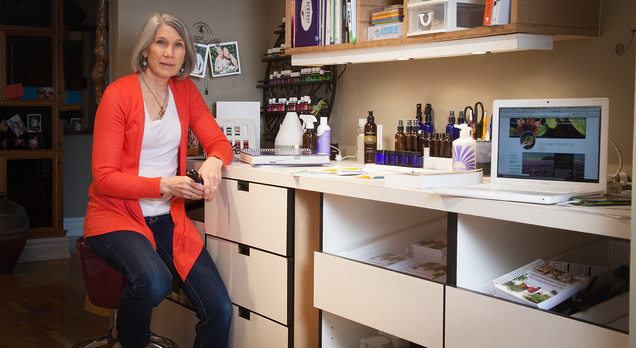 patty-sitting-at-a-row-of-repurposed-pharmacy-cabinets