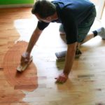 eric wiping stain on hardwood floors